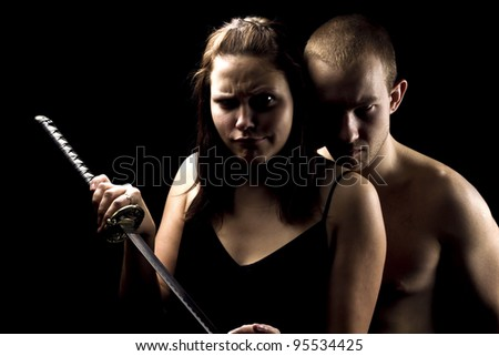 Young man and woman with sword