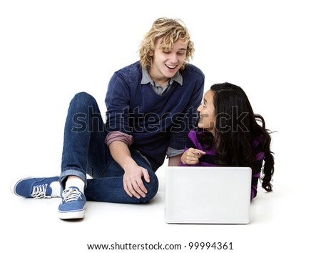 young man and woman working together on laptop