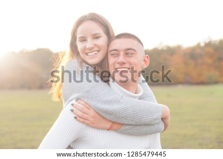 Young man and young woman are having fun outdoors