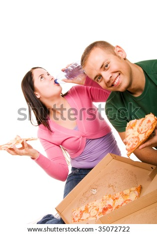 Young man and young woman eating pizza