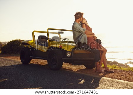 Young man and young woman on road trip on a beautiful summer\'s day.