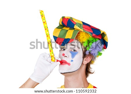 Young man as clown with whistle - isolated