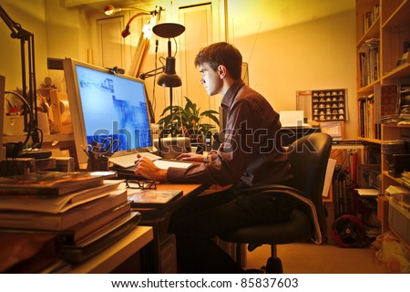 Young man at home using a computer