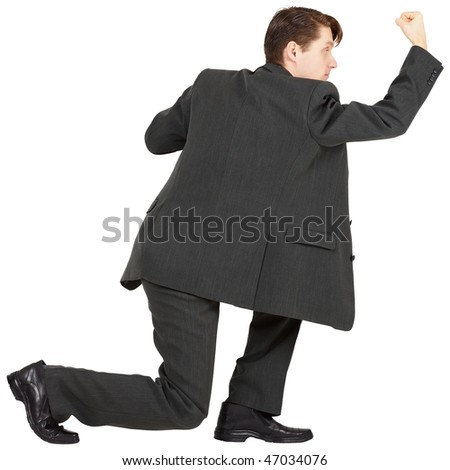 Young man beats his fist on a white background