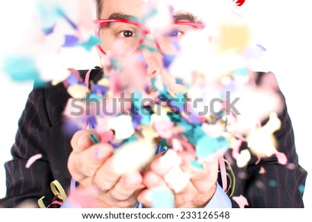 Young man blowing confetti #233126548