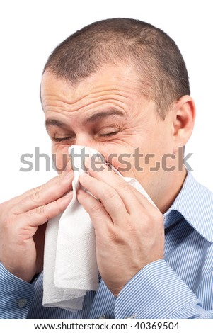 Young man blowing nose, isolated on white background