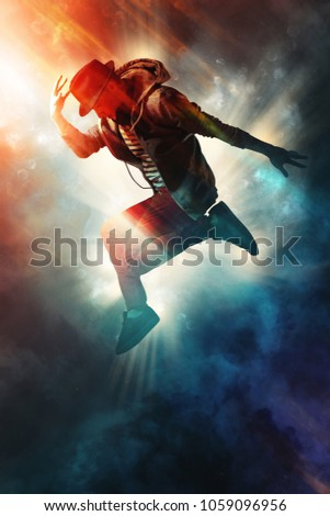 Young man break dancing on smoke background Сток-фото ©