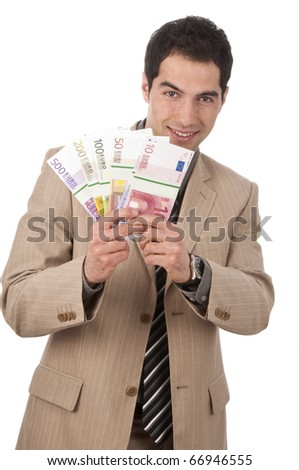 Young man, business man in light suit wag notes and smiles