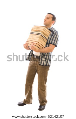Young man carrying a pile of books