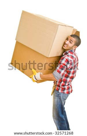 Young man carrying huge boxes