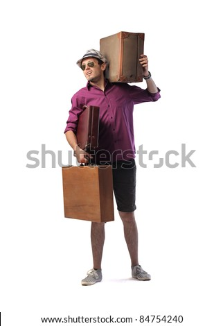 Young man carrying two big suitcases