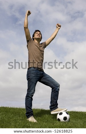 Young man celebrate something with his arms up
