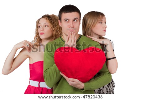 Young man choosing between two women with red heart in hands