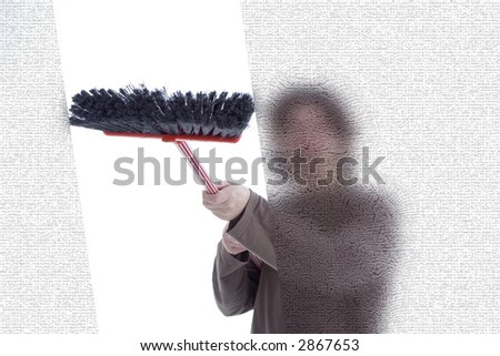 Young man cleaning windows with a broom