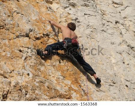 Young man climbing a difficult route, ?rni Kal, Slovenija.