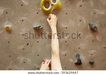 Young man climbing indoor #393629647