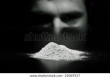 stock-photo-young-man-cocaine-addicted-looking-with-temptation-to-white-powder-focus-on-white-powder-32069317.jpg