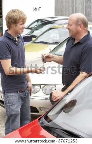 Young man collecting new car