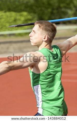 Young man concentrates to throw his spear