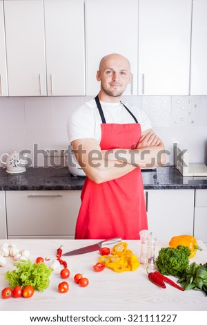 Young Man Cooking. Healthy Food - Vegetable Salad. Diet. Dieting Concept. Healthy Lifestyle.