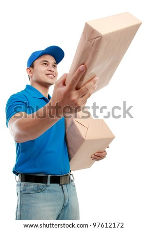 Young man courier in blue uniform with packages isolated on white background