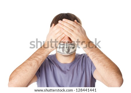 Young man covering his eyes with his hands and his mouth sealed by a hundred dollar bills for bribe concept isolated on white background
