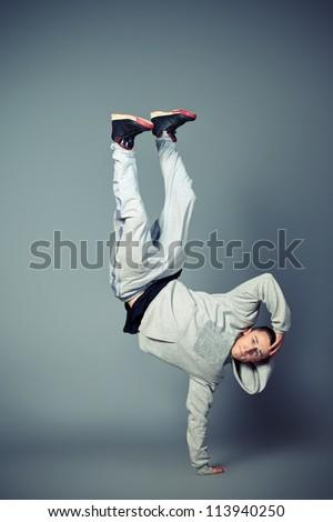 Young man dancing hip-hop at studio.