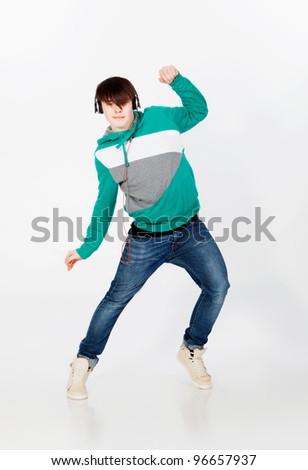 Young man dancing in studio