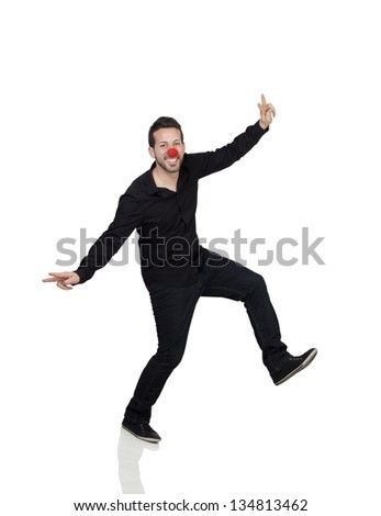 Young Man Dancing With Clown Nose Over White Background