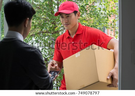 Young man Delivering Package to customer at home. Delivery #749078797