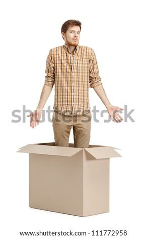 Young man doesn't know why he is inside the box, isolated, white background