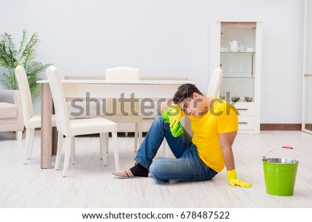 Young man doing chores at home #678487522