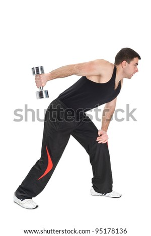 Young man doing Standing Dumbbell One Arm Triceps Extensions on Fitnes Ball, phase 2 of 2.