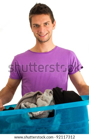 Young man doing the washing and smiling