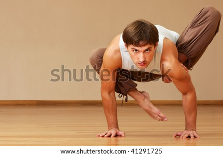 young man doing yoga indoor