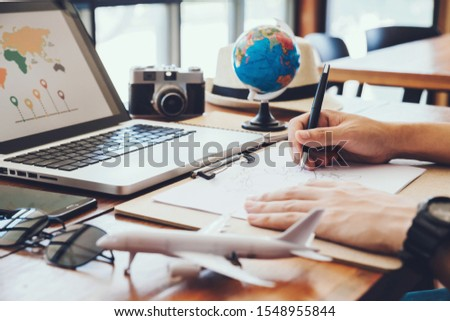 Young man Draw maps for tourism planning vacation trip.travel , trip vacation,