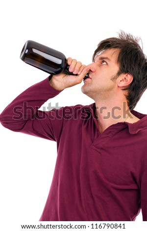 Young man drinking alcohol. Isolated on white