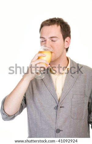 Young man drinking beer on white background