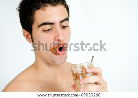 Young man drinking chocolat smoothie