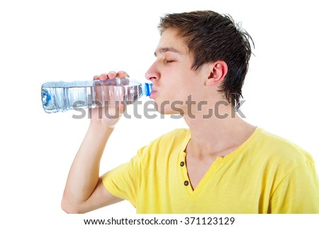 Young Man drinking the Pure Water on the White Background