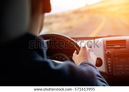 Young man driving car #571613905