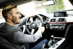 Young man driving in the  modern car