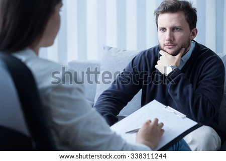 Young man during therapy at psychologist\'s office