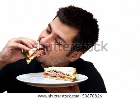 young man eating a sandwich isolated on white