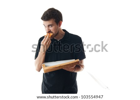 Young man eating pizza isolated on white