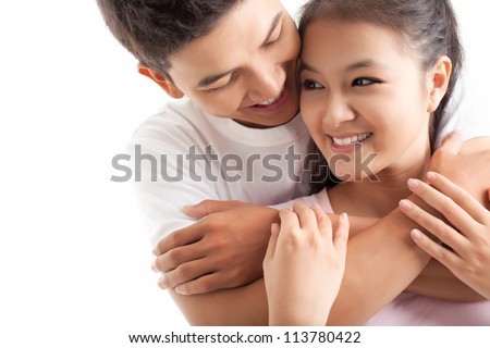 Young man embracing his girlfriend