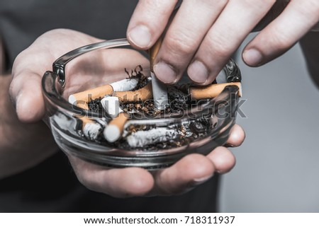 Young man ending smoking cigarette