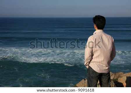 Young man enjoying a beautiful seascape