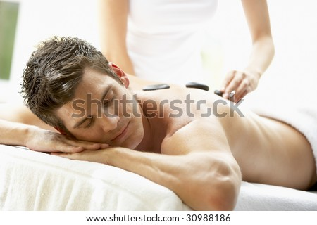 Young Man Enjoying Hot Stone Treatment