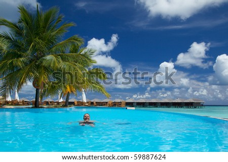 Young Man Enjoying Infinity Pool In The Maldives!